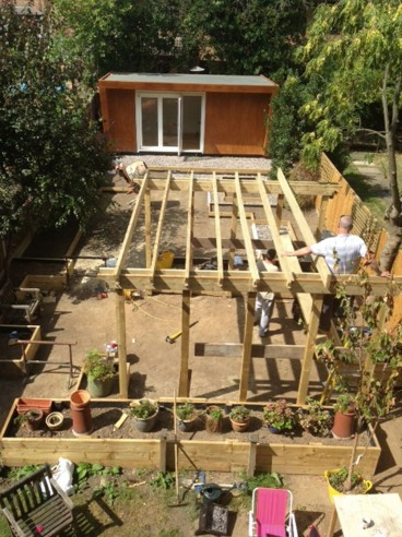 Large dining space being created under a bespoke timber arbour